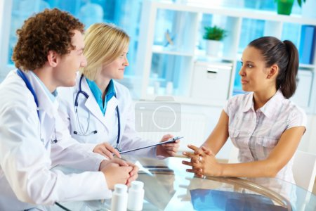 Photo for Portrait of confident practitioners consulting patient in hospital - Royalty Free Image
