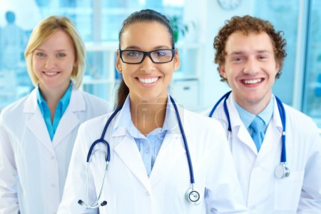 Photo for Portrait of three therapeutists looking at camera with smiles - Royalty Free Image