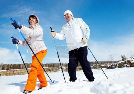 Photo for Portrait of mature couple skiing outside - Royalty Free Image