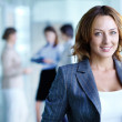 Image of pretty businesswoman looking at camera...