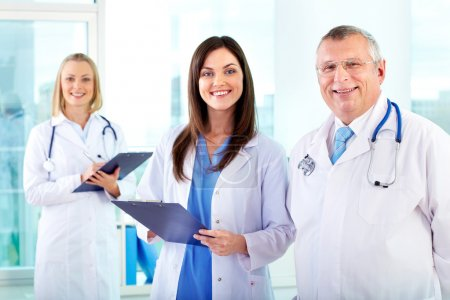 Photo for Portrait of successful therapeutists looking at camera in hospital - Royalty Free Image