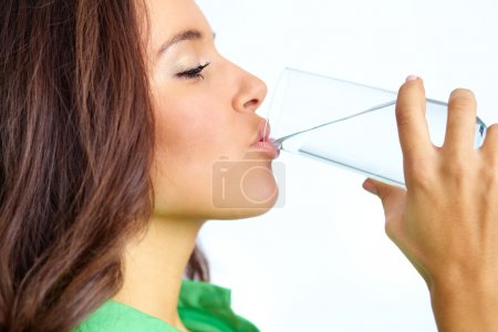Photo for Close-up of pretty girl drinking water from glass - Royalty Free Image