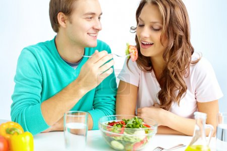 Photo for Happy couple eating vegetable salad - Royalty Free Image