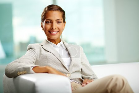 Photo for Portrait of successful female sitting in office - Royalty Free Image
