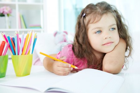 Photo for Portrait of lovely girl drawing with colorful pencils - Royalty Free Image