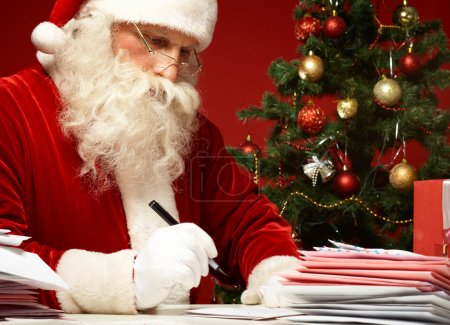 Photo for Portrait of Santa Claus answering Christmas letters - Royalty Free Image