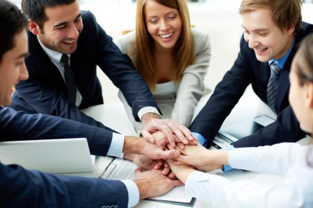 Photo for Image of business partners making pile of hands at meeting - Royalty Free Image