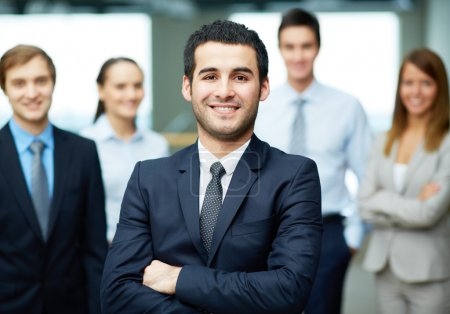 Photo for Group of friendly businesspeople with male leader in front - Royalty Free Image
