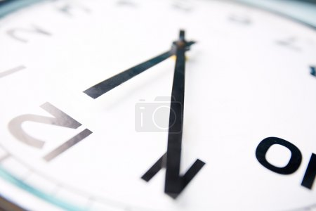 Photo for Close-up image of a clock showing five minutes to twelve - Royalty Free Image