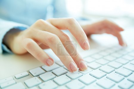 Photo for Hands of an office woman typing - Royalty Free Image