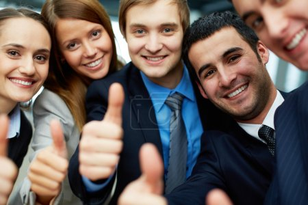 Photo for Portrait of five business partners keeping thumbs up and looking at camera with smiles - Royalty Free Image