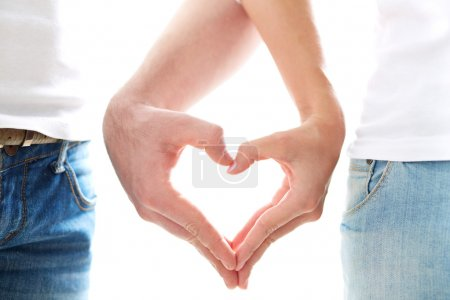 Photo for Conceptual image of female and male hands making up heart shape - Royalty Free Image