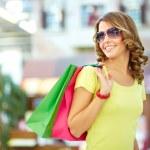 Cool shopping girl enjoying a carefree weekend at ...