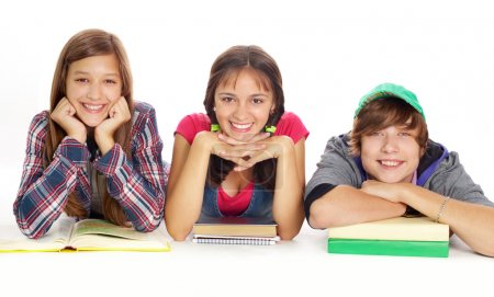 Photo for Cute teens with books smiling at camera - Royalty Free Image