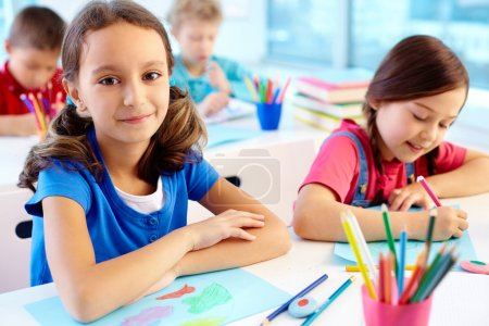 Photo for Lovely kids drawing at art lesson at school - Royalty Free Image