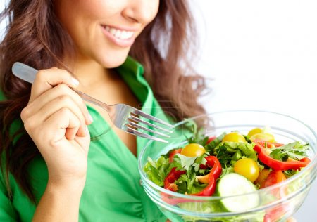 Photo for Close-up of pretty girl eating fresh vegetable salad - Royalty Free Image