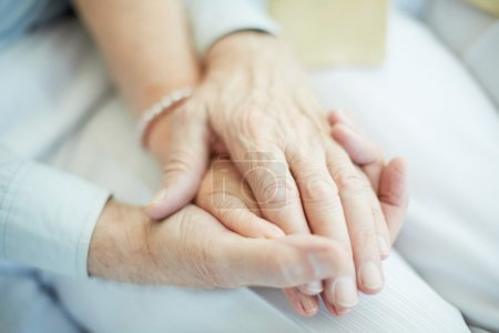 Photo for Close-up of senior male holding the hand of his wife - Royalty Free Image