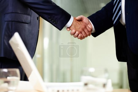 Photo for Close-up of two men handshaking after making agreement - Royalty Free Image