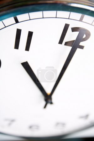 Photo for Macro shot of a clock face showing eleven o'clock - Royalty Free Image