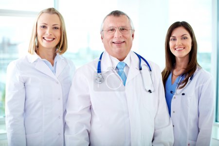 Photo for Portrait of three happy therapeutists looking at camera - Royalty Free Image