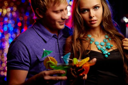 Photo for Image of posh couple spending leisure in the night club - Royalty Free Image