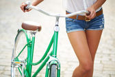 Legs of bicyclist