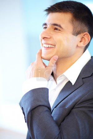 Photo for Portrait of cheerful businessman touching his chin - Royalty Free Image