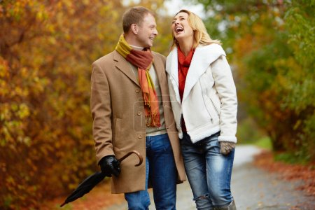 Photo for Portrait of ecstatic couple during walk in autumnal park - Royalty Free Image