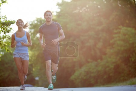 Photo for Photo of happy couple running outdoors - Royalty Free Image