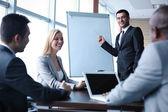 Business people interacting at seminar
