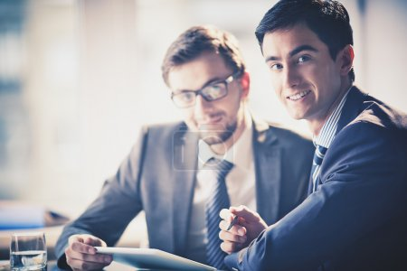 Photo for Image of smart young businessmen looking at camera at meeting - Royalty Free Image