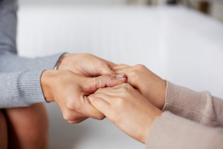 Photo for Close-up of psychiatrist hands holding those of her patient - Royalty Free Image
