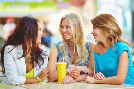 Girls chatting while having drink