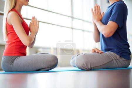 Woman and man doing yoga exercise