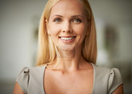 Photo for Smiling woman with blond hair looking at camera - Royalty Free Image