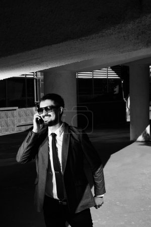 Miling businessman speaking on the phone
