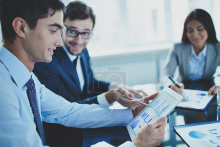 Businessman pointing at document in touchpad