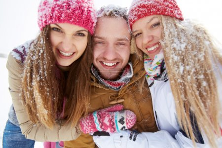 Affectionate friends in winter