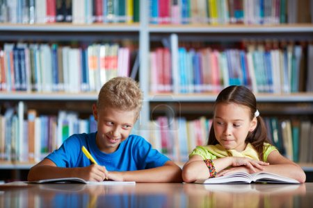 Photo for Portrait of diligent schoolchildren sitting at lesson - Royalty Free Image