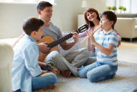 Family playing musical instruments