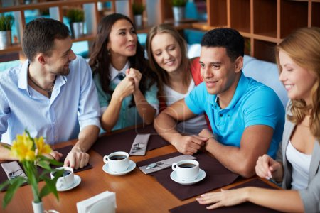 Photo for Portrait of large group of teenage friends sitting in cafe - Royalty Free Image