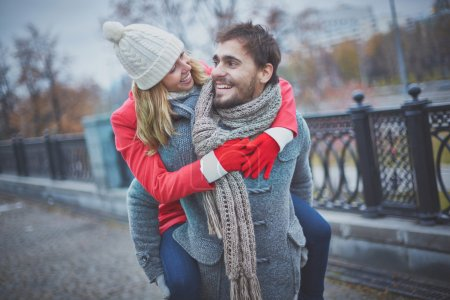 Photo for Image of affectionate girl on her boyfriend back in park - Royalty Free Image