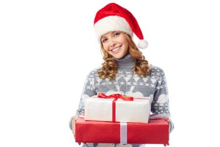 Girl in Santa cap holding giftbox