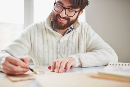 Photo for Image of happy young man drawing - Royalty Free Image