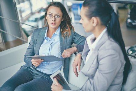 Businesswomen discussing