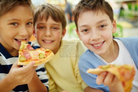 Boys enjoying pizza