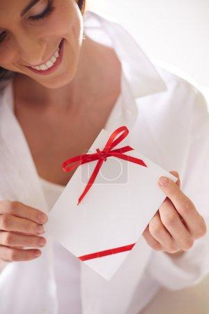 Female holding valentine letter