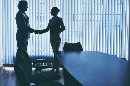 Photo for Businessman and businesswoman handshaking in office - Royalty Free Image