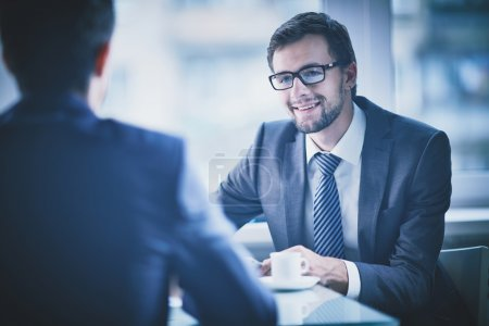 Businessman having talk with his colleague
