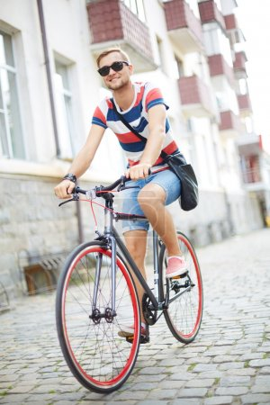 Guy riding bicycle